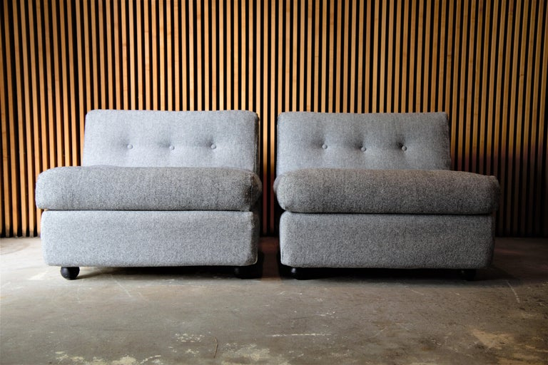 A pair of fiberglass Amanta chairs designed by Mario Bellini for B&B Italia. New maharam hallingdal wool fabric. These examples imported from Italy.   Condition: Light wear and abrasion to the white fiberglass shells, overall show very well.