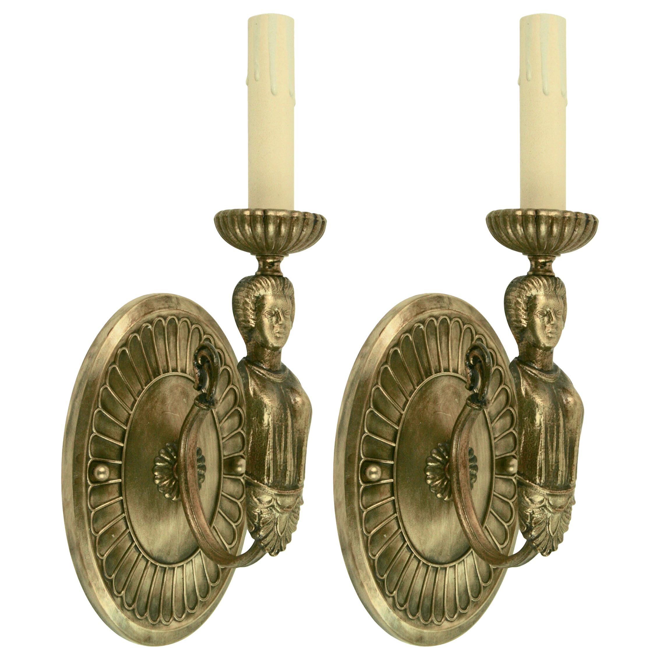 Pair of Figural Brass Sconce