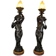 Pair of Figural Bronze Torcheres