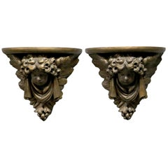Pair of Figural Classical Cherub Composite Wall Shelves, 20th Century