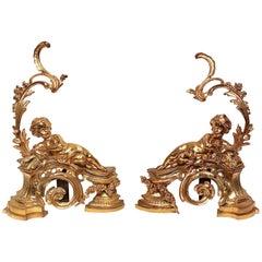 Pair of Figural Louis XV Style Cherub Motif Ormolu Bronze Andirons