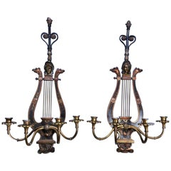 Pair of Figural Neoclassical Lyre Ebonized Bronze and Brass Sconces, circa 1920