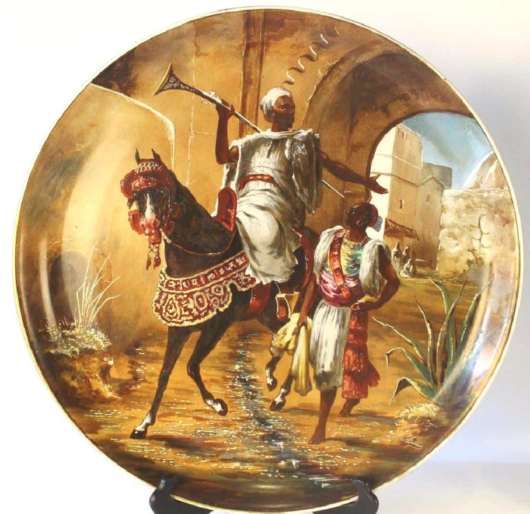 Our two painted porcelain chargers from Bernardaud of Limoges, France, date from circa 1910 and depict Arabian fighters on horseback. Each signed Dusson and one carries the additional signature Cojou.