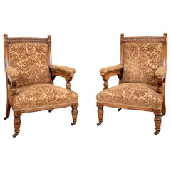 Pair of Fine Antique English Aesthetic Movement Lolling Chairs