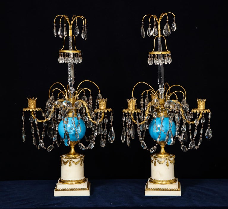 A pair of exquisite and highly important large antique Russian neoclassical gilt bronze, blue opaline glass, cut crystal and white marble candelabras of superb quality embellished with blue opaline glass, cut crystal chains, crystal prisms on gilt