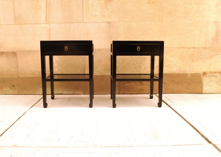 Pair of fine black lacquer end tables, with drawers and shelf. Very elegant and fine quality and beautiful color. We carry fine quality furniture with elegant finished and has been appeared many times in
