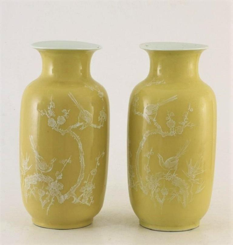 A fine pair of Chinese porcelain yellow-ground vases decorated with birds and floral motifs, China, late 19th century. Each marked at the bottom. Condition: Both vases in fine original condition, some wear, no chips or cracks, no