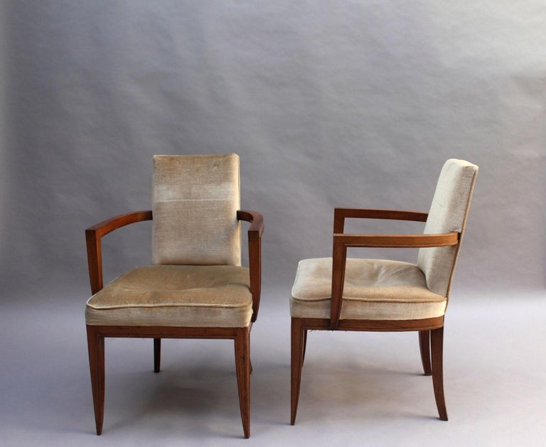 Maxime Old (1910 - 1991): A pair of fine French Art Deco rosewood armchairs with a flat molding highlighting the shape of the frame. A matching club chair is also available (not include in pricing) see last images.