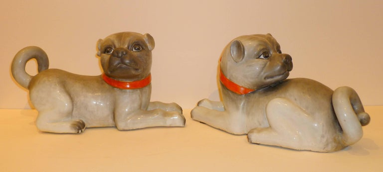 A pair of lively modeled porcelain dogs, Fine details and colors.