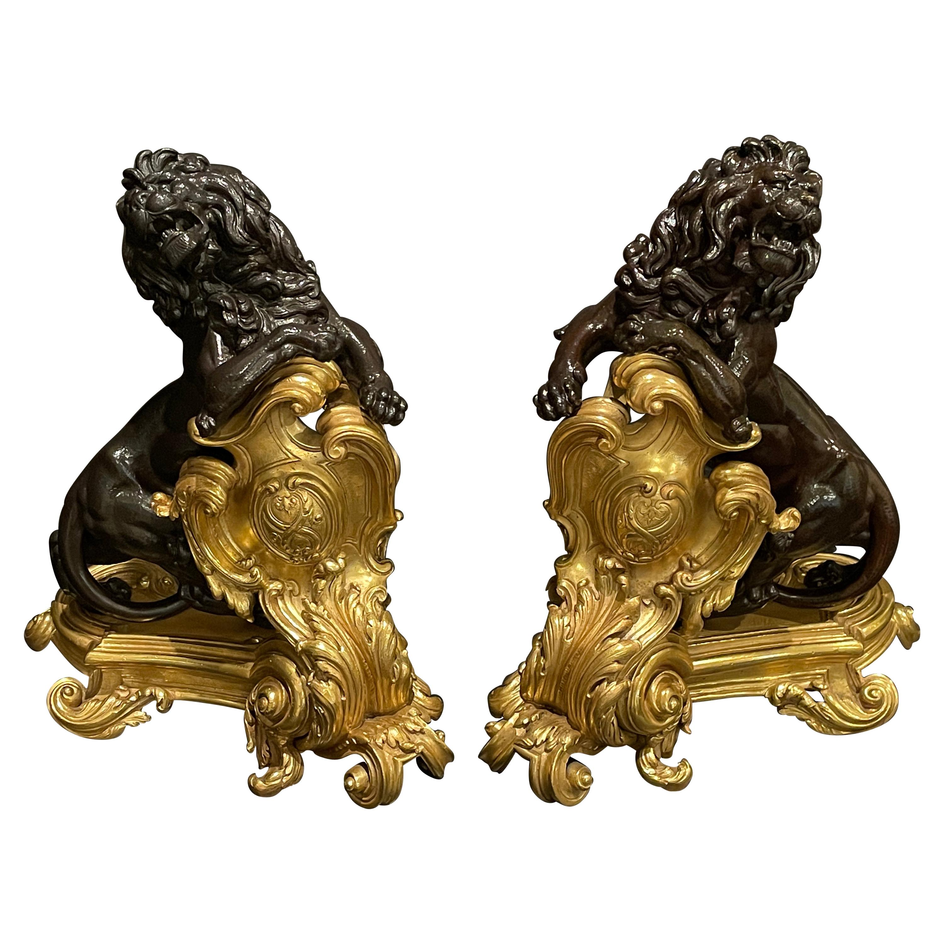 Pair of Fine Patinated and Gilt Lion Chenets
