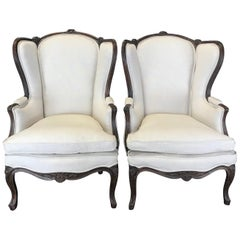 Pair of Finely Carved 19th Century French Louis XV Wing Armchairs