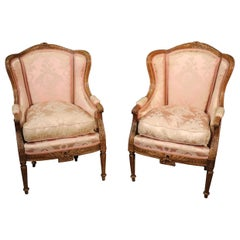 Pair of Finely Carved French Louis XV Oak Wingback Bergère Chairs, circa 1890