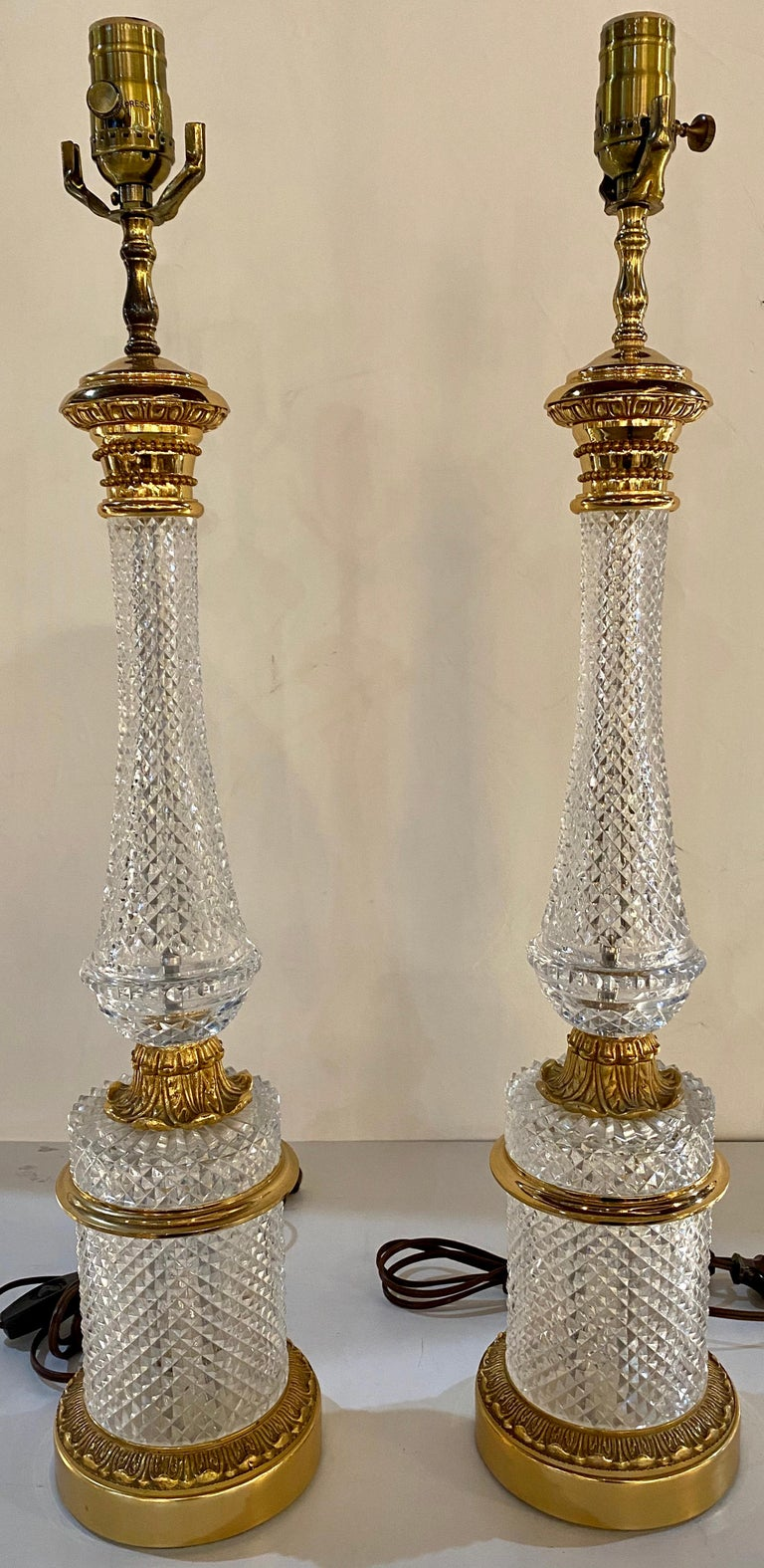 Pair of finely cut glass table lamps with bronze mounting Baccarat style. These column-form lamps do not have harps or shades.