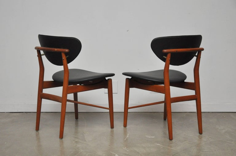 Brass Pair of Finn Juhl NV-55 Dining Chairs For Sale