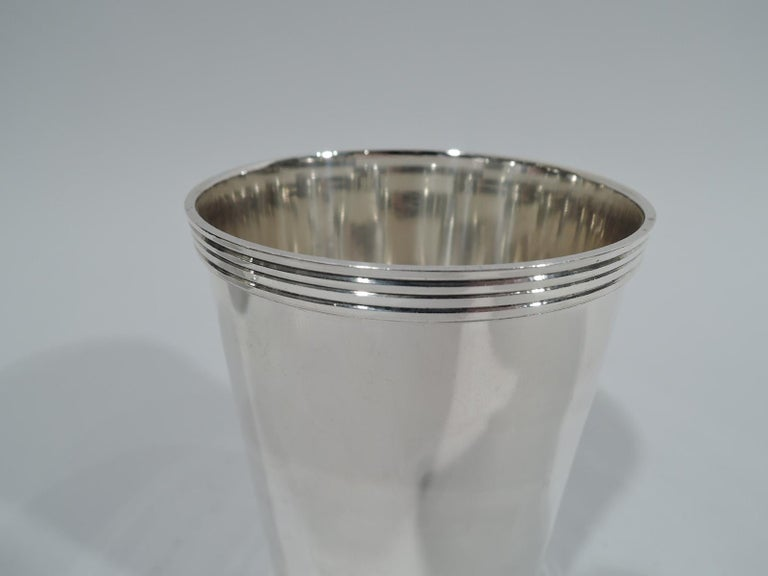 Pair of traditional sterling silver mint julep cups. Made by Fisher in Jersey City. Each: Straight and tapering sides, and reeded rim and foot. Great for a booze-for-two night. Fully marked and numbered 50. Total weight: 7.5 troy ounces.