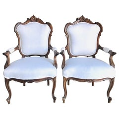 Pair of Fit for Royalty French Louis XV Carved Walnut Fauteuil Armchairs