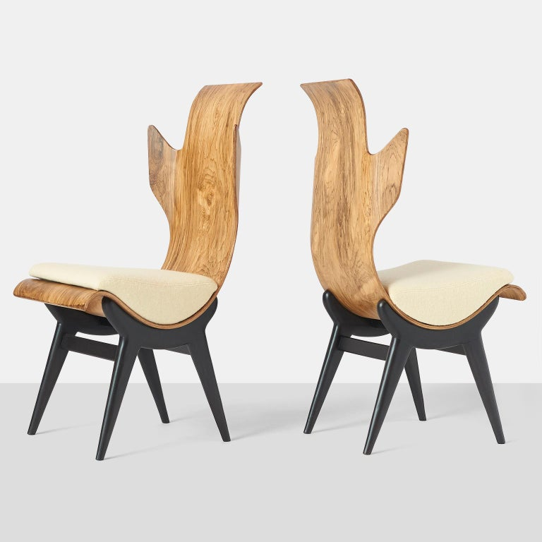 A pair of very rare and sculptural Pozzi & Verga model '2/R' or 'Flame' chairs, designed by Dante LaTorre. The chairs are made of bent, laminated rosewood on an ebonized ash frame. They have fixed cushions with a ivory boiled wool upholstery. The