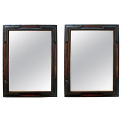 Pair of Flemish Ebonized Mirrors