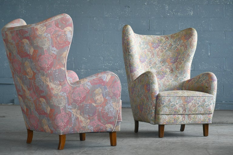 Beautiful Flemming Lassen attributed high back lounge chairs made, circa 1940. This iconic lounge chair is probably one of the most perfect high backs ever designed. Perfect statement piece with its ultra-elegant sensual shape yet very comfortable