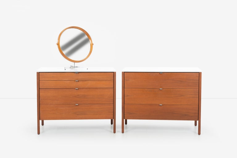 Pair of Florence Knoll 4-drawer dressers, model 324-1 walnut cases with oil finish, satin aluminum pulls with laminated plastic durable tops. Label underside [Knoll International].