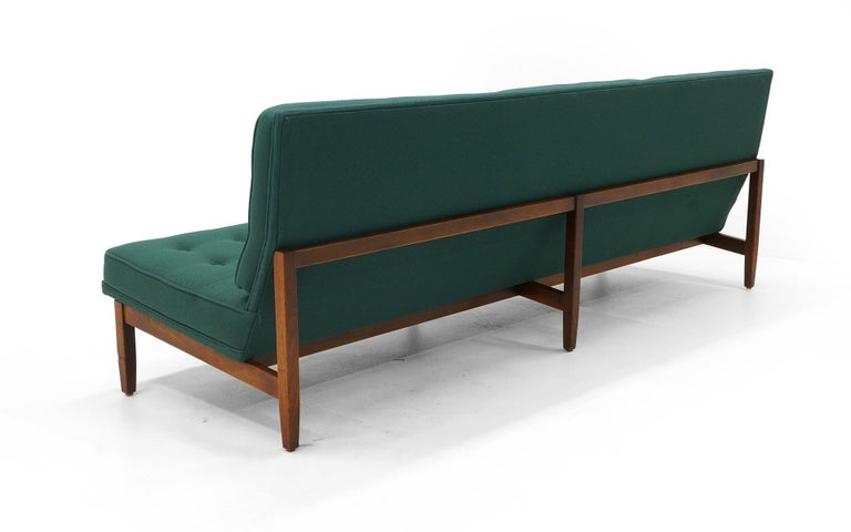 Mid-20th Century Pair of Florence Knoll Armless Sofas, Walnut Frames and Original Green Fabric For Sale