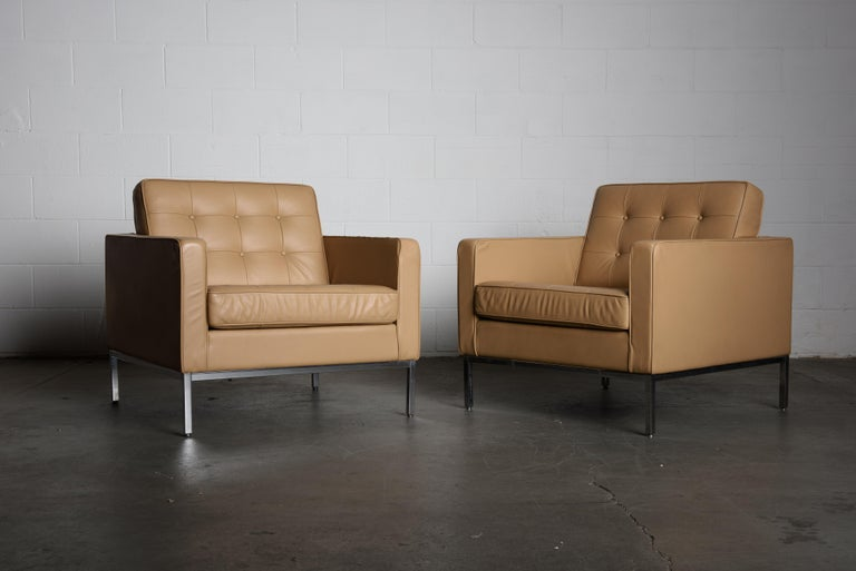 This pair of Florence Knoll leather lounge chairs for Knoll Studio feature soft supple leather over a chrome base, with a Knoll Studio embossed stamp and Florence Knoll's signature embossed on one leg of each chair, and Knoll repeat fabric on the
