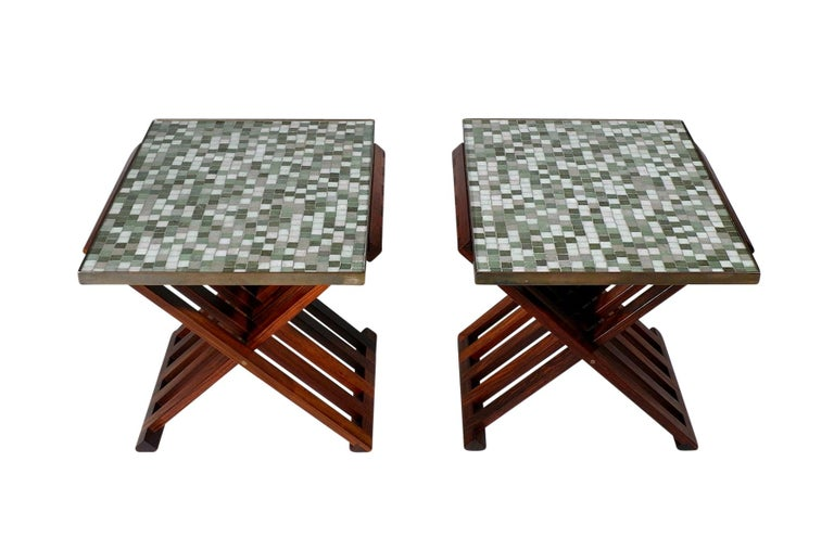 Rare matched pair of tables by Edward Wormley for Dunbar. Folding solid rosewood frames with inset Murano glass tile tops. Table model #5425.