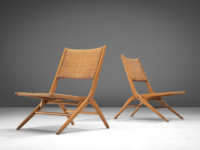 Pair of folding slipper chairs, cane and beech, Italy, 1960s