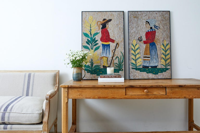 Charming pair of framed folk artworks or paintings made of mosaic tiles. Depicts a colonial-style man and woman among blooming vegetation. Beautifully crafted with vibrant colored tiles. Set in ebonized wood frames with minor losses as seen in