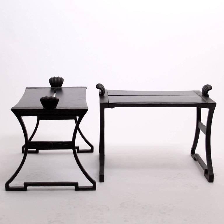 Folke Bensow - Scandinavian Modern  A beautiful pair of benches (Park Bench No. 1) designed by Folke Bensow, Sweden, 1920s.   The benches are painted cast iron and wood (black). The benches has patina from having being used in a garden. The