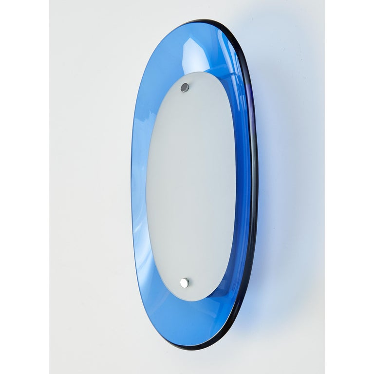 Fontana Arte, 1960s Modernist pair of oval sconces in clear sapphire blue glass with beveled edge, and opaline glass diffuser Size: 12.5 H x 6 W x 3 Proj. Rewired for use in the USA with single candelabra base bulb, backplate provided for use