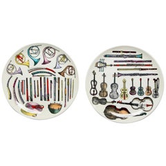 Pair of Fornasetti Musical Instrument Themed Plates