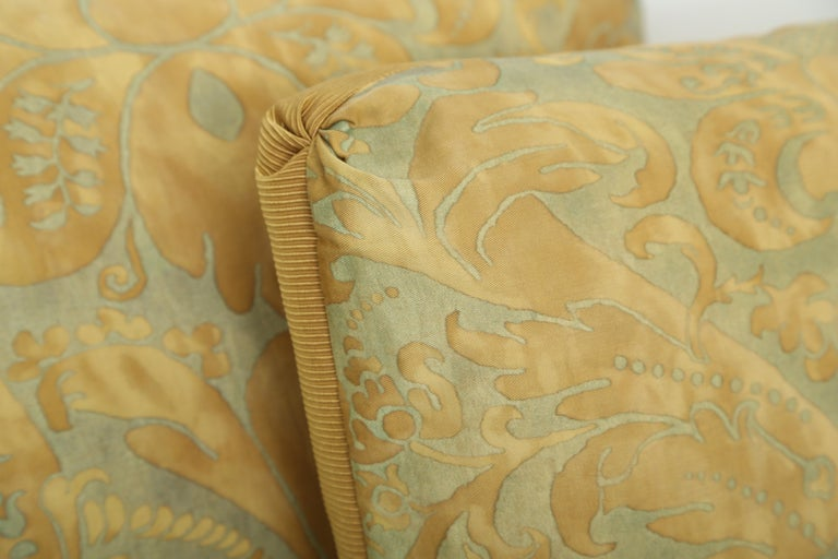 Pair of Fortuny cushions newly made from vintage fabric in the Caravaggio pattern. Put together in an oblong shape by skilled hands, they have butterfly corners and a hidden zipper at the bottom. The inserts are 50/50 feather and down. (There are