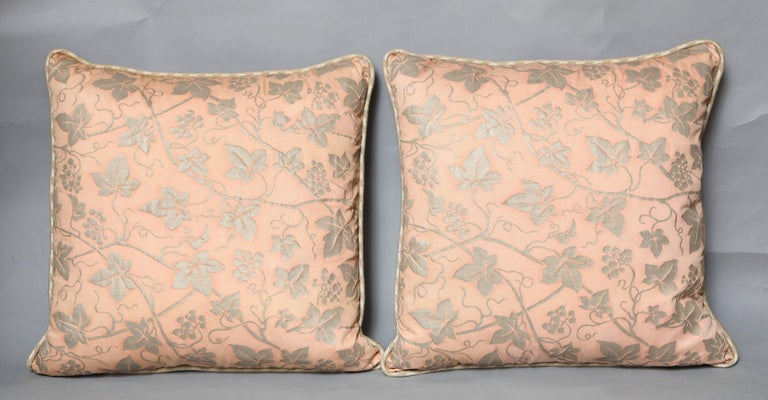 A pair of Fortuny fabric cushions in the Edera pattern, pale pink and silver with linen welt trim and silver striped linen backs, the pattern, a 19th century Spanish design with ivy leaf motif  50 down/50 feather insert Newly made using vintage