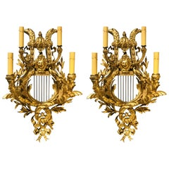 Pair of Four-Light Louis XVI Style Bird & Face Mounted Gilt Bronze Wall Sconces
