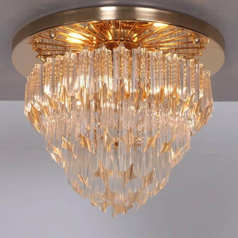 Brass Pair of Four-Tiered Venini Murano 'Astra Quadrilobo' Chandeliers, Italy, 1960 For Sale