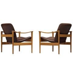 Pair of Fredrik A. Kayser Easy Chairs in Oak