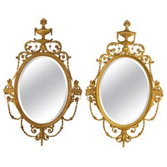 Pair of Freidman Brothers Compatible Sphinx Gilt Gold Beveled Oval Wall Mirrors