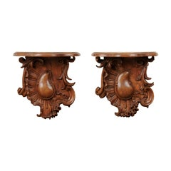 Pair of French 1760s Louis XV Period Walnut Wall Brackets with Rocailles Motifs