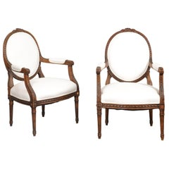 Pair of French 1850s Louis XVI Style Walnut Oval Back Upholstered Armchairs