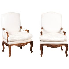 Pair of French 1850s Régence Style Fauteuils with Carved Shells and Upholstery