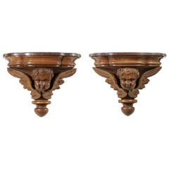 Pair of French 1880s Carved Walnut Brackets with Cherubs and Faux Marble Tops