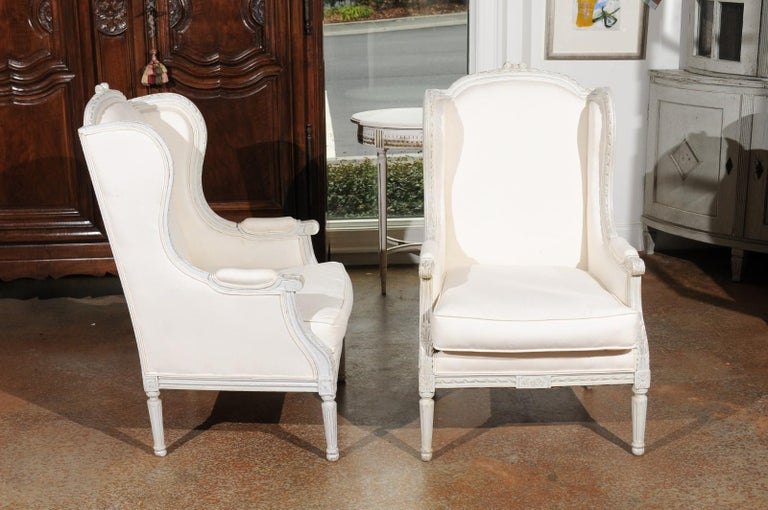 19th Century Pair of French 1890s Louis XVI Style Painted Wood Bergère Chairs with Upholstery For Sale