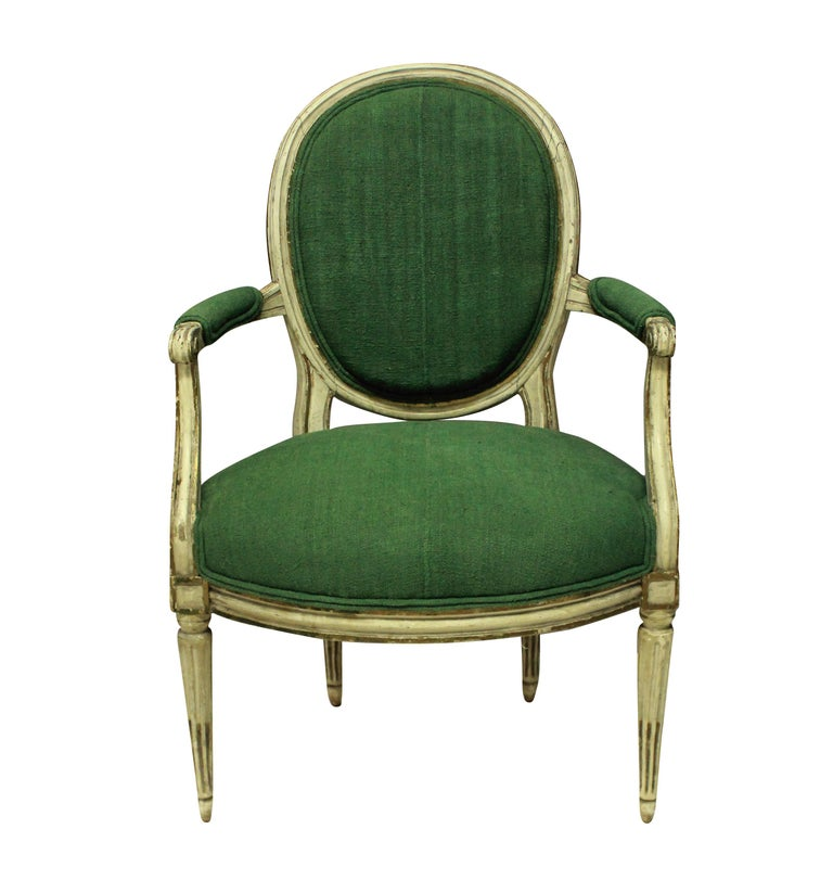 A pair of French 18th century painted armchairs. In their original condition, newly upholstered in 19th century hand died French linen.