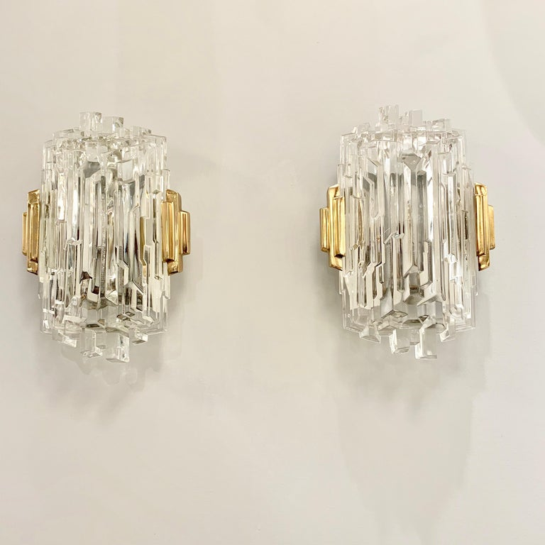 A wonderful pair of 1970s ice crystal wall lights with polished brass frames. Newly rewired.