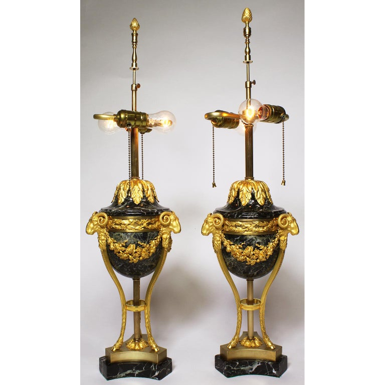 A fine pair of French 19th-20th century Louis XV style gilt bronze (Ormolu) Mounted and Vert Maurin marble (Veined Green Marble) figural urn Lamps. The ovoid variegated green marble bodies, each surmounted with ram's mask monopodia conjoint by