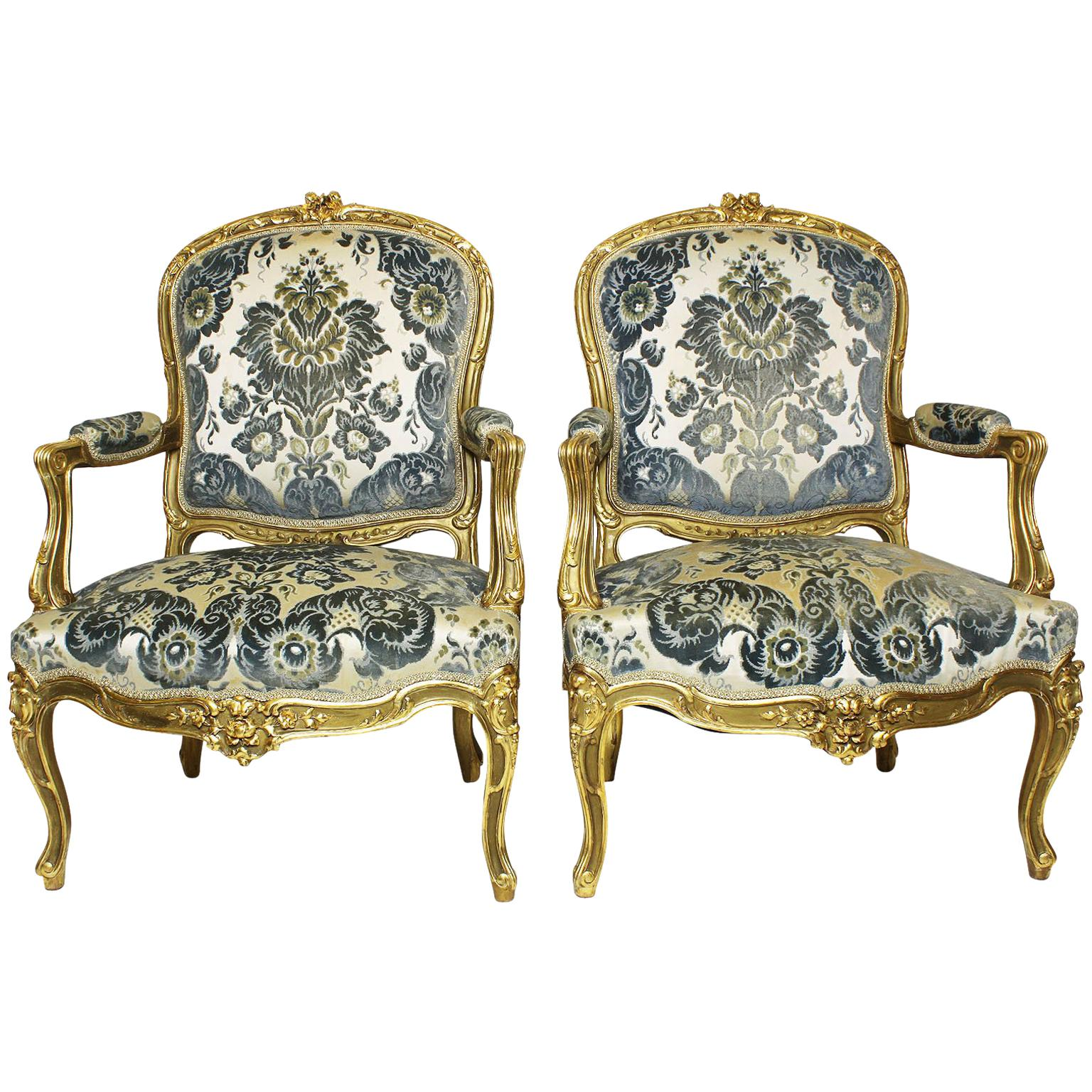 Pair of French 19th-20th Century Louis XV Style Giltwood Carved Rococo Armchairs