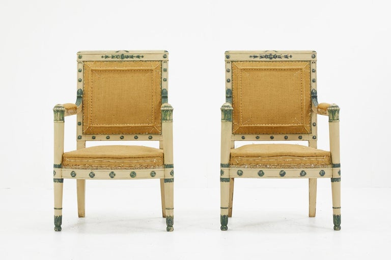Pair of early 19th Century French painted chairs with carved decoration. Circa 1810.  Sofa also available. Item No. 1433  They have been upholstered using high quality natural burlap fabric. Can be left and used as they are but they are also