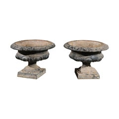 Pair of French 19th Century Cast Iron Garden Urns with Foliage and Ovoid Motifs