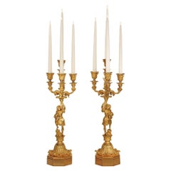 Pair of French 19th Century Charles X Ormolu Four Arm Candelabras